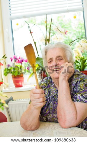 Angry old woman in the kitchen