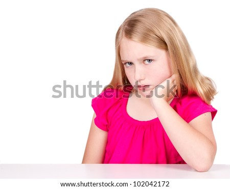 Angry or upset child or pre-teen isolated on white background