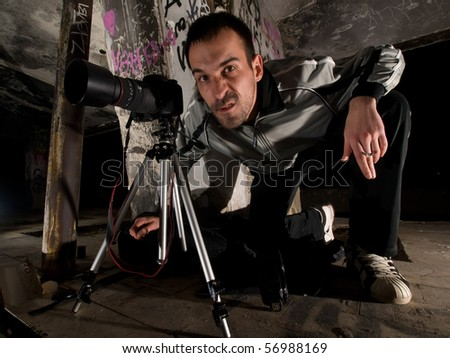 angry paparazzi photographer after missing a shoot - stock photo