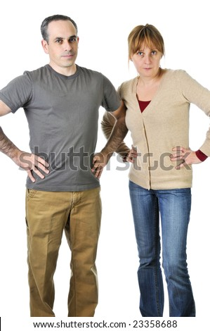 Angry parents stare with disappointment at the camera - stock photo