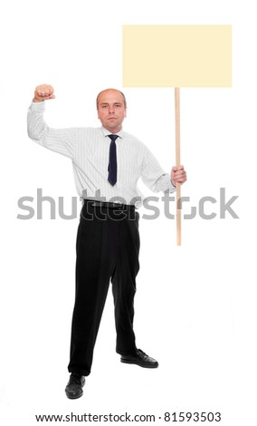 Angry protesting businessman with blank protest sign.