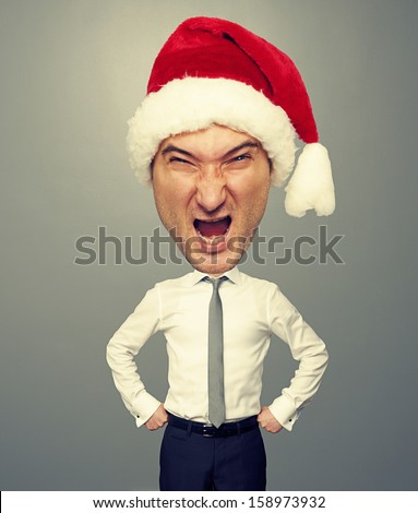 angry santa man with big head over grey background