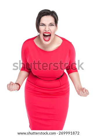 Angry screaming beautiful plus size woman in red dress isolated  - stock photo