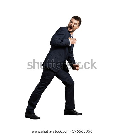 angry screaming man holding invisible rope. isolated on white background