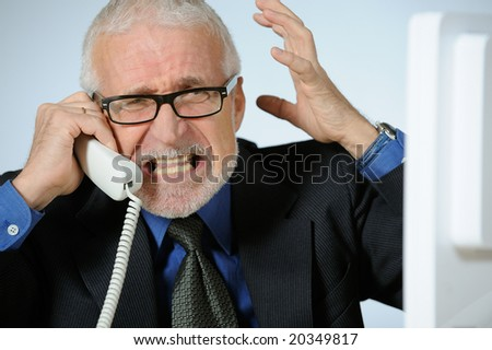 Angry senior businessman - stock photo