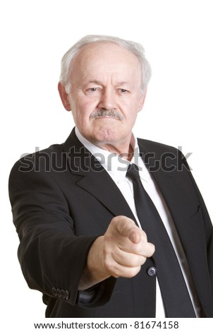 Angry senior businessman pointing with his finger and giving out orders, isolated on white.