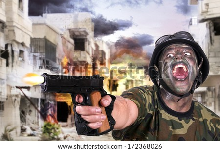 Angry Soldier firing a gun. - stock photo