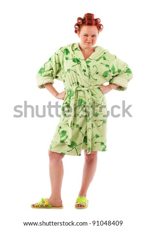 angry stereotypical houswife with hair rollers in green terry bathrobe