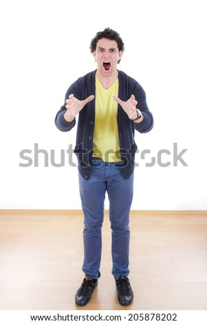 Angry stressed young man writhes hands screaming with despair, Portrait of frustrated man under pressure expressing anger - stock photo