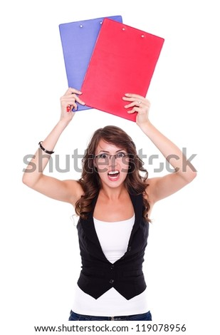 Angry student girl holding booklets over white background - stock photo