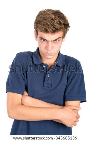 Angry teenage boy making faces isolated in white - stock photo