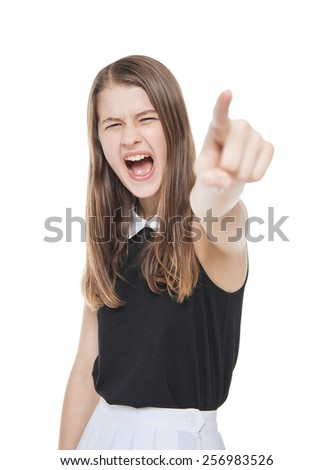 Angry teenage girl screaming and showing by finger isolated on white background - stock photo