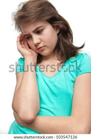 Angry teenage girl standing isolated against white background