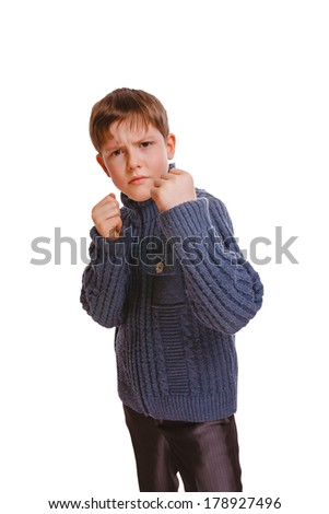 angry teenager boy clenched his fists fight isolated on white background - stock photo