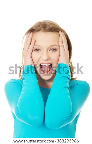 Angry teenager screaming  - stock photo