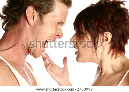 Angry thirty something couple yelling at each other. - stock photo