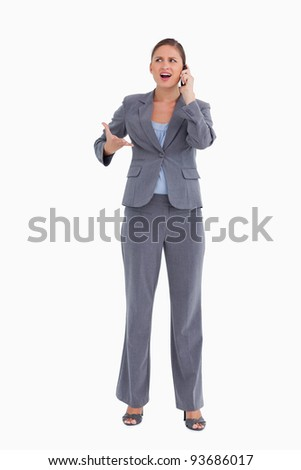 Angry tradeswoman yelling at caller against a white background - stock photo