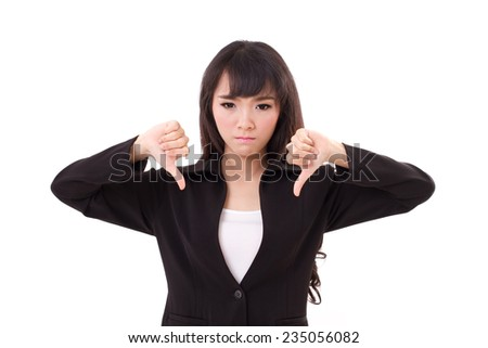 angry, upset businesswoman giving, showing thumb down hand gesture on white isolated background, concept of not ok, rejection, nonacceptance, failure, negative result - stock photo
