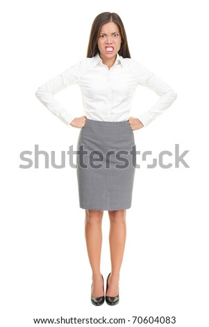 Angry upset young business woman standing isolated in full length. Funny image of mixed race Asian Caucasian female model. - stock photo