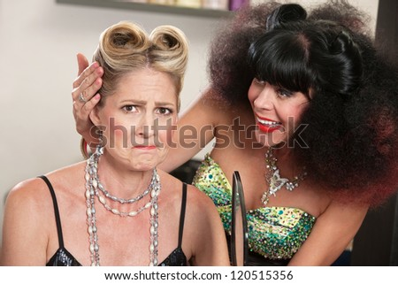 Angry white female with problem hairdo and comforting friend - stock photo