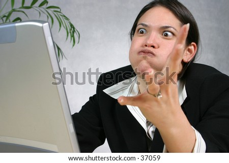 Angry with computer - stock photo