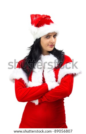 Angry woman dressed in Santa Claus costume with arms crossed - stock photo