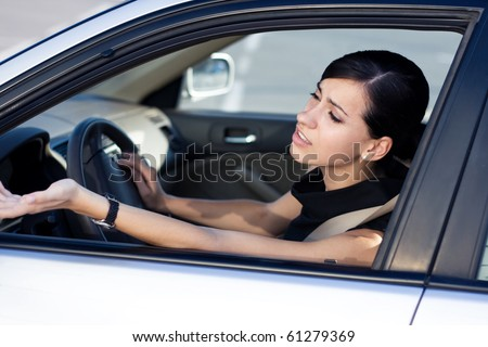 Angry woman driver stuck in traffic jam - stock photo