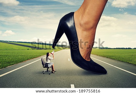 angry woman screaming at big lady boss on the road - stock photo