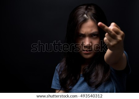 Angry woman show her middle finger