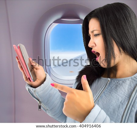 angry woman trip because your smart phone no signal inside of an airplane