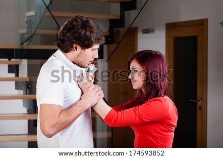 Angry woman using violence to her partner during the quarrel  - stock photo