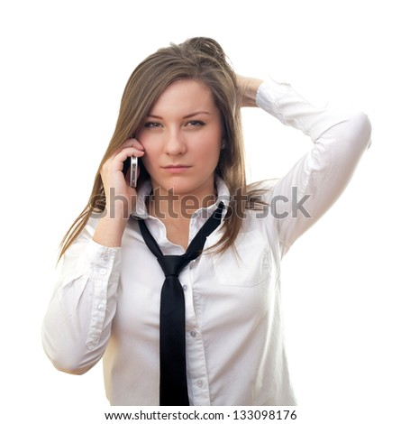 Angry woman with cellphone on isolated background - stock photo