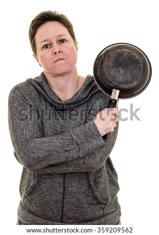Angry woman with crossed arms holding frying pan. White background with copy space - stock photo