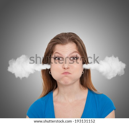 Angry woman with smoke from her head - stock photo