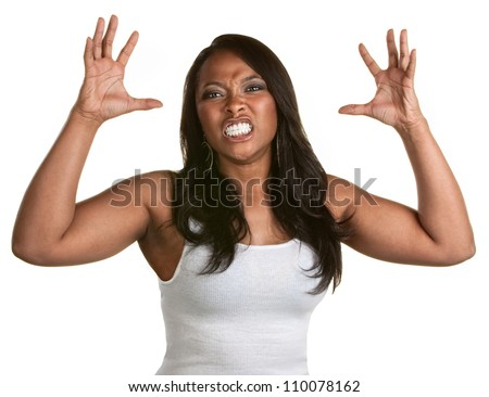 Angry woman with teeth clenched and hands out - stock photo