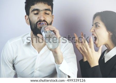 Angry woman yelling at her lazy husband