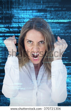 Angry yelling businesswoman against shiny blue coding on black background - stock photo