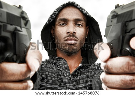 Angry Young Black Adult Male with Handguns - stock photo
