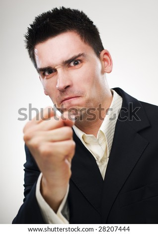 angry young business man close up shoot - stock photo