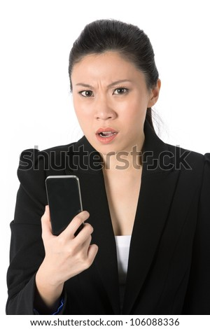 Angry young businesswoman reading bad news on her cell phone. Isolated on white background. - stock photo