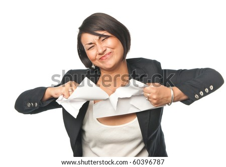 Angry young businesswoman tearing paper - stock photo