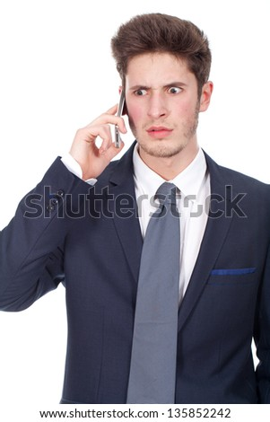 Angry young executive using cellphone