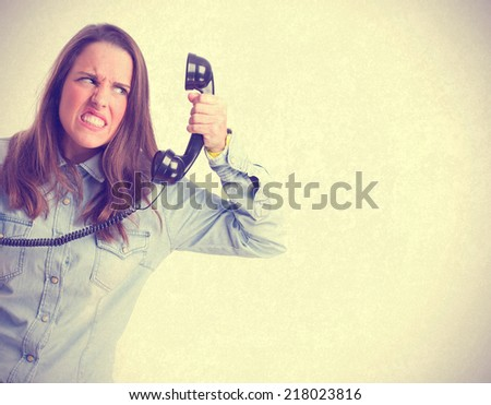 angry young girl talking phone. isolated - stock photo