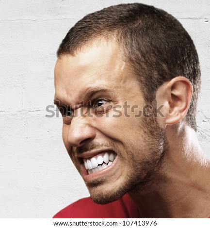 angry young man against a grunge background - stock photo