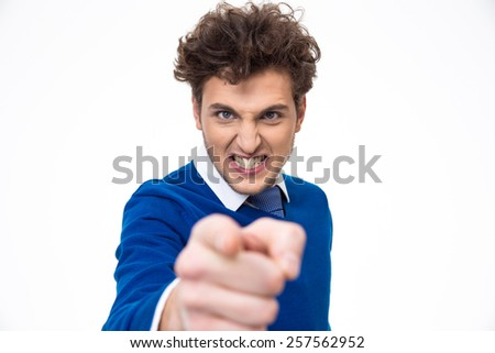 Angry young man pointing at you over white background - stock photo