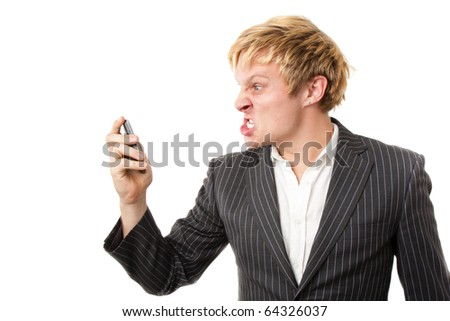 Angry young man shouting on the phone - stock photo
