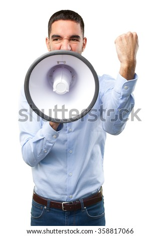 Angry young man with a megaphone