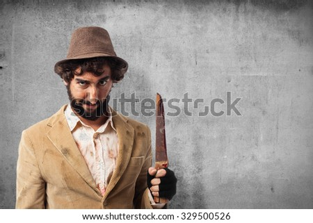 angry young man with knife