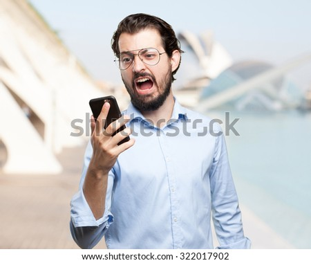 angry young man with mobile - stock photo