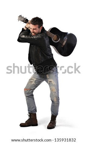 angry young musician with guitar